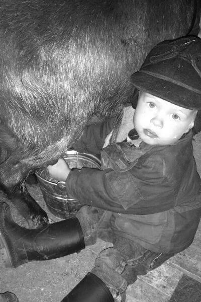 3 year old milking a goat. Is raw milk safe for young kids?